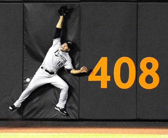 Florida marlins outfielder cody ross fails to catch a triple by new